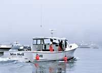 Lobster boat escaping the fog.  Boothbay Harbor, ME.  (C) Rob Kleine, All Rights Reserved, www.gentleye.comBoothbay Harbor, Maine. (c) Rob Kleine All Rights Reserved.  www.gentleye.com